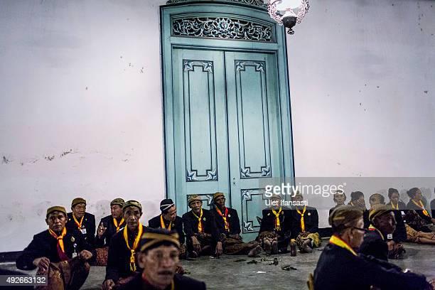 Javanese people sit on yard of Kasunanan Surakarta awaiting the traditional night carnival '1st Suro' marking the 1437th Islamic New Year...