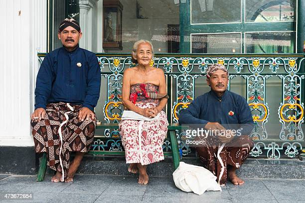 javanese people wearing traditional clothing at yogyakarta palace indonesia - kraton stock pictures, royalty-free photos & images