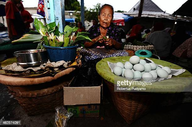 Javanese woman keep on her merchandise during Sekaten festival at Surakarta Mosque on January 14 2014 in Solo City Indonesia Indonesia celebrates the...