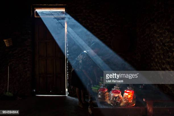 Javanese woman prepares food in her house during a Nyadran ritual at the Sidorejo village on May 4 2015 in Boyolali Central Java Indonesia The...