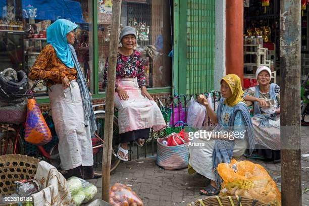Javanese women chatting at market in Chinatown Kampung Pecinan Semawis of the city Semarang Central Java Indonesia