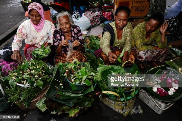 Javanese women keep on her merchandise during Sekaten festival at Surakarta Mosque on January 14 2014 in Solo City Indonesia Indonesia celebrates the...