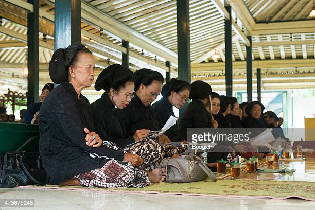 javanese women sit preparing to sing at yogyakarta palace ceremony - kraton stock pictures, royalty-free photos & images