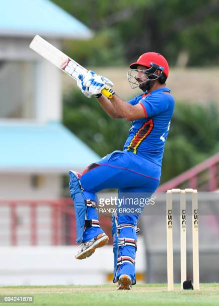Javed Ahmadi of Afghanistan hits 4 during the 1st ODI match between West Indies and Afghanistan at Darren Sammy National Cricket Stadium Gros Islet...