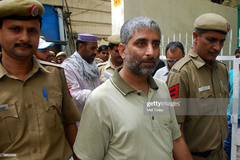 Javed Ahmed Khan, one of the convicts of the 1996 Lajpat Nagar blast case, is escorted out of a court after pronouncement of the sentence against him in New Delhi on April 22, 2010. The court sentenced him with rigorous life imprisonment.