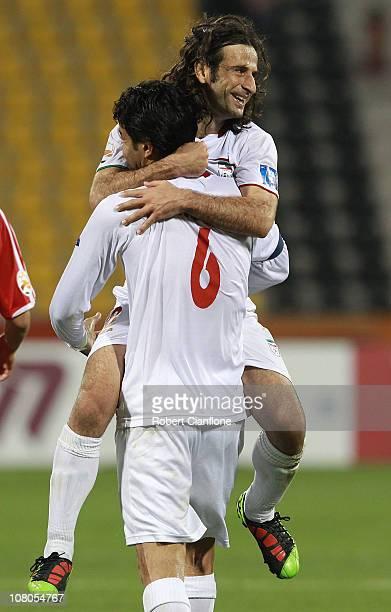 Javed Nekonam and Pejman Nouri of Iran celebrate after Iran defeated DPR Korea at the AFC Asian Cup Group D match between DPR Korea and Iran at Qatar...