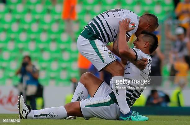 Javeir cortes and Osvaldo Martinez of Santos celebrate during the quarter finals second leg match between Santos Laguna and Tigres UANL as part of...