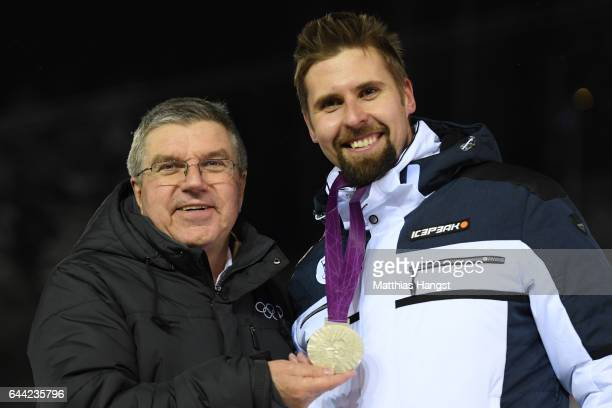 Javelin thrower Antti Ruuskanen of Finland is presented by IOC President Thomas Bach with the 2012 Olympic silver medal upgraded from bronze...