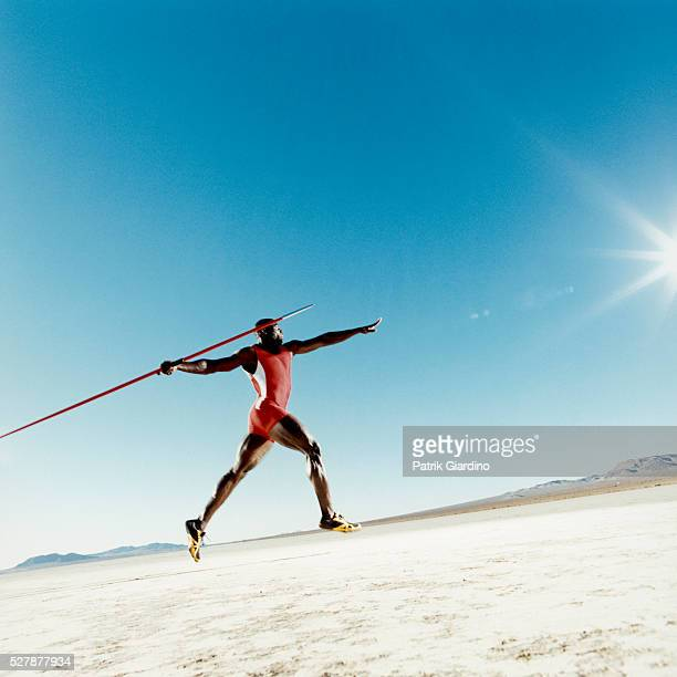 javelin thrower in motion - javelin stock pictures, royalty-free photos & images