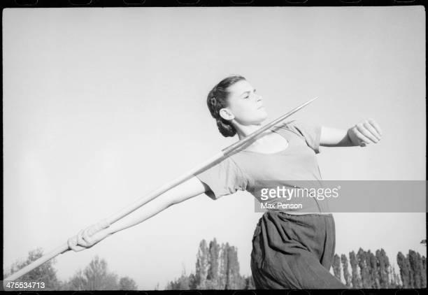 Javelin throwing sportswoman, circa 1940.