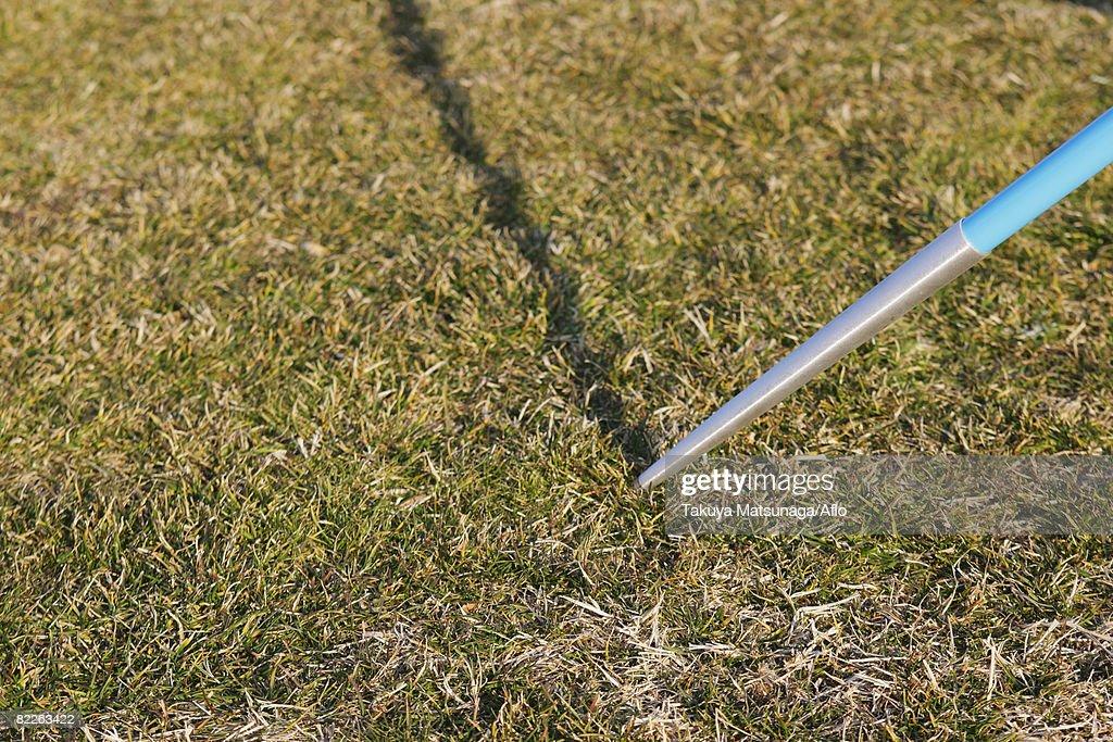 Javelin Thrown into the Ground : Stock Photo