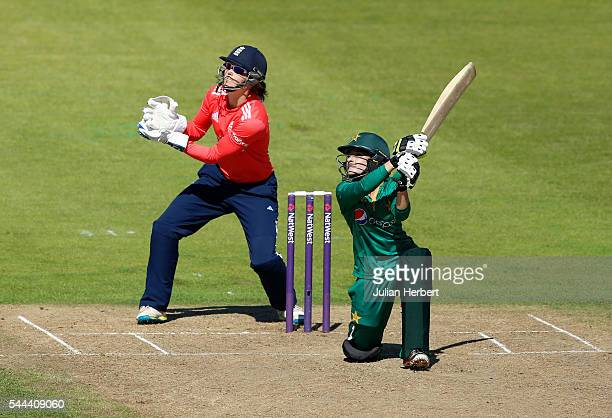 Javeria Kahn of Pakistan hits out as Amy Jones of Englnd looks on during the 1st Natwest International T20 played between England Women and Pakistan...