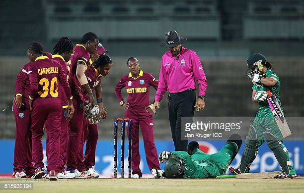 Javeria Khan of Pakistan collapses after being struck on the head of the bowling of Shamilia Connell of the West Indies with Merissa Aguilleira and...