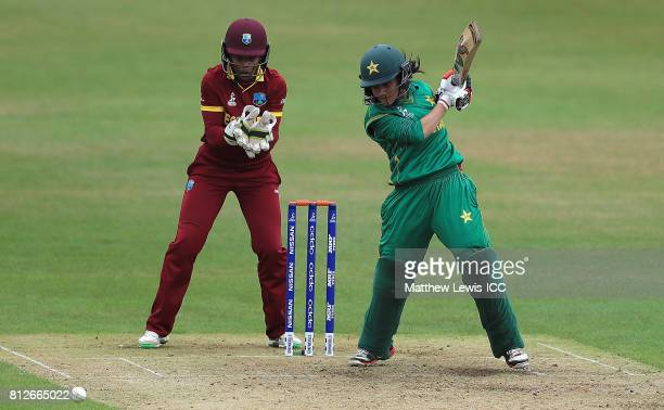 Javeria Khan of Pakistan hits the ball towards the boundary as Merissa Aguilleira of the West Indies looks on during the ICC Women's World Cup 2017...