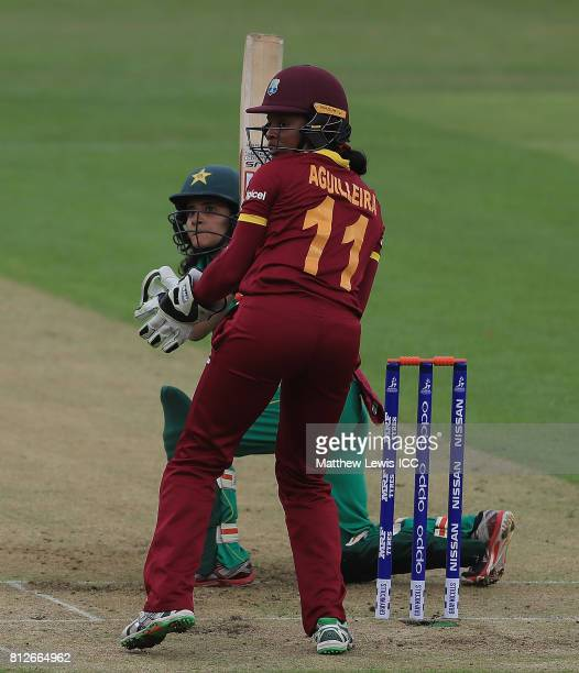 Javeria Khan of Pakistan sweeps the ball towards the boundary as Merissa Aguilleira of the West Indies looks on during the ICC Women's World Cup 2017...