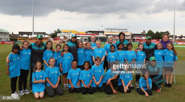 Javeria Wadood Sana Mir Nain Abidi and Asmavia Iqbal of Pakistan in action with local school children during the ICC Cricket for Good clinic at Grace...