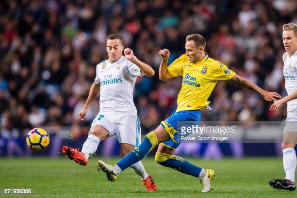 Javi Castellano Betancor of UD Las Palmas fights for the ball with Lucas Vazquez of Real Madrid during the La Liga 201718 match between Real Madrid...