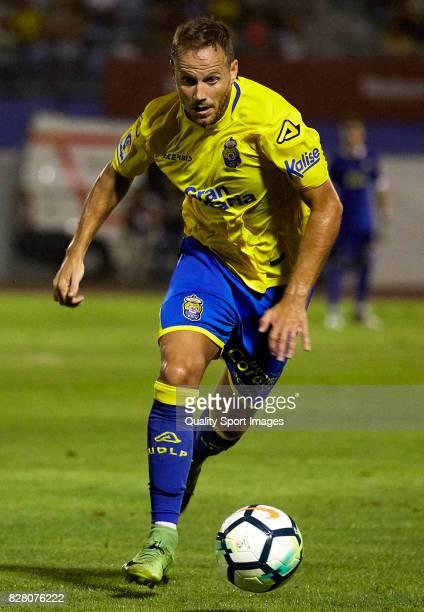 Javi Castellano of Las Palmas runs with the ball during the Pre Season Friendly match between Las Palmas and Tenerife at Municipal de Maspalomas...