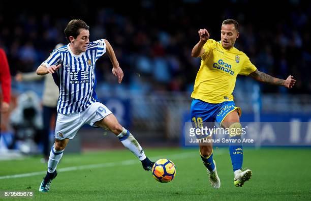 Javi Castellano of UD Las Palmas duels for the ball with Alvaro Odriozola of Real Sociedad during the La Liga match between Real Sociedad de Futbol...
