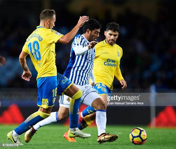 Javi Castellano of UD Las Palmas duels for the ball with Carlos Vela of Real Sociedad during the La Liga match between Real Sociedad de Futbol and UD...