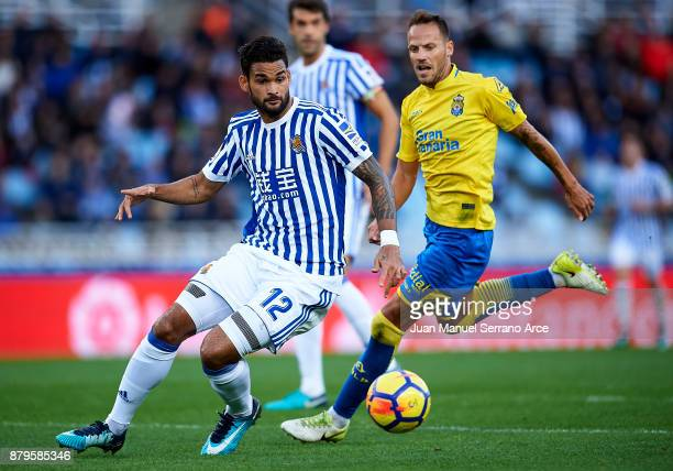Javi Castellano of UD Las Palmas duels for the ball with Willian Jose Da Silva of Real Sociedad during the La Liga match between Real Sociedad de...