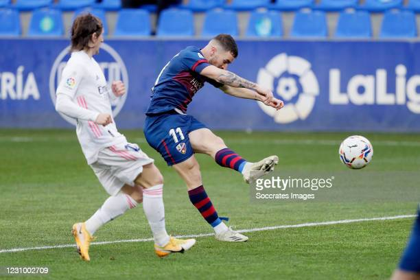 Javi Galan of SD Huesca scores the first goal to make it 1-0 during the La Liga Santander match between SD Huesca v Real Madrid on February 6, 2021