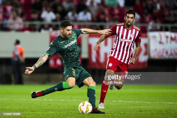 Javi García of Betis vies with Ahmed Hassan of Olympiacos during the UEFA Europa League Group F match between Olympiacos and Real Betis at...