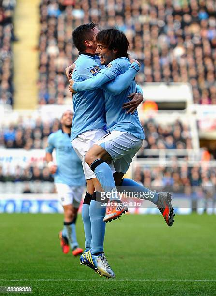 Javi Garcia and David Silva of Manchester City celebrate the second goal during the Barclays Premier League match between Newcastle United and...