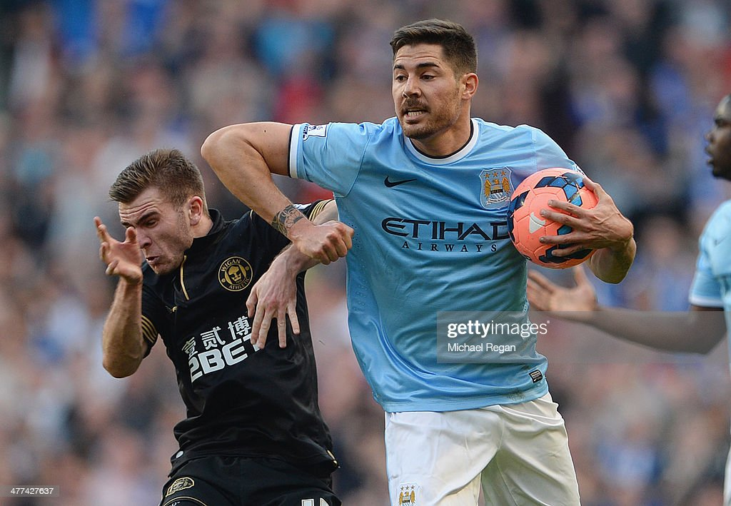 Javi Garcia of Man City clashes with Callum McManaman oif Wigan during the FA Cup Quarter-Final match between Manchester City and Wigan Athletic at the Etihad Stadium on March 9, 2014 in Manchester, England.