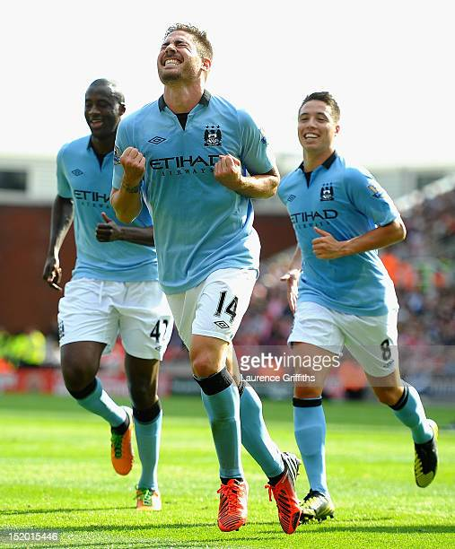 Javi Garcia of Manchester City celebrates scoring the equalising goal followed by Samir Nasri and Yaya Toure during the Barclays Premier League match...