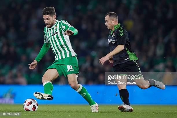 Javi Garcia of Real Betis competes for the ball with Enrique Vivero of Racing de Santander during the Spanish Copa del Rey second Leg match between...