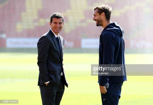 Javi Gracia Manager of Watford and Fernando Llorente of Tottenham Hotspur in discussion prior to the Premier League match between Watford FC and...