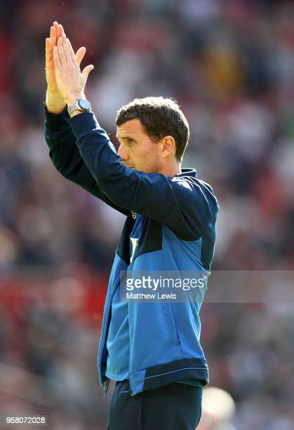 Javi Gracia Manager of Watford applauds fans during the Premier League match between Manchester United and Watford at Old Trafford on May 13 2018 in...