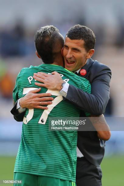 Javi Gracia Manager of Watford embraces Roberto Pereyra of Watford following victory in the Premier League match between Wolverhampton Wanderers and...