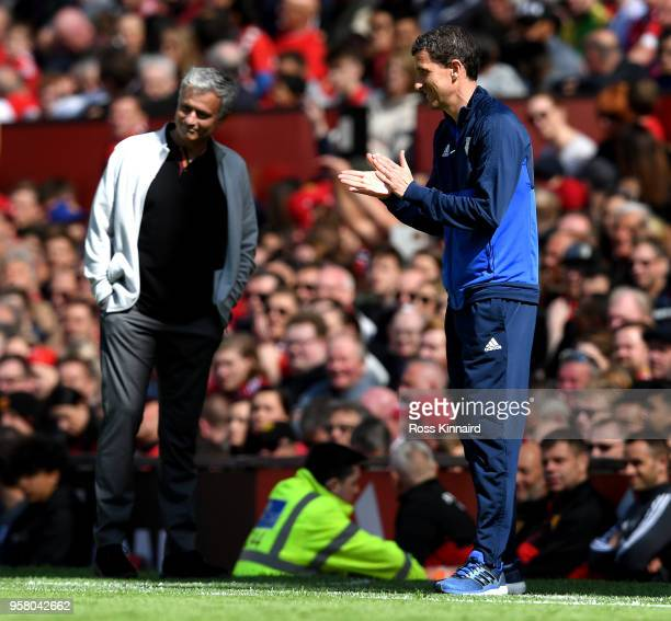 Javi Gracia Manager of Watford reacts as Jose Mourinho Manager of Manchester United looks on during the Premier League match between Manchester...
