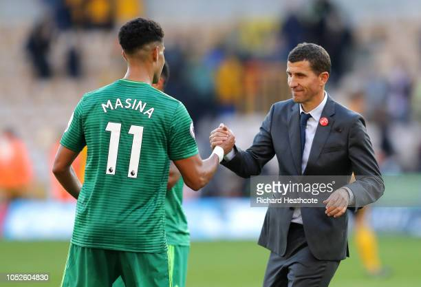 Javi Gracia Manager of Watford shakes hands with Adam Masina of Watford following victory in the Premier League match between Wolverhampton Wanderers...