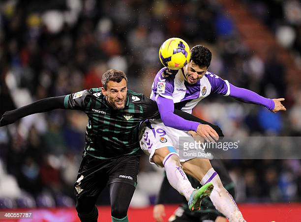 Javi Guerra of Real Valladolid CF battles for he ball against Antonio Amaya of Real Betis Balompie during the La Liga match between Real Valladolid...