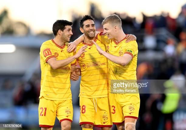 Javi Lopez, Juande and Jordan Elsey of Adelaide celebrate victory after the A-League Elimination Final match between Brisbane Roar and Adelaide...