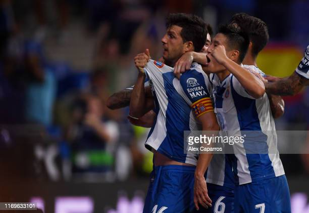 Javi Lopez of Espanyol celebrates wuth teammates after scoring his team's second goal during the UEFA Europa League Play Off match between Espanyol...