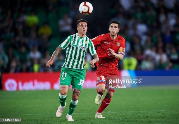 Javi Lopez of RCD Espanyol duels for the ball with Cristian Tello of Real Betis Balompie during the La Liga match between Real Betis Balompie and RCD...