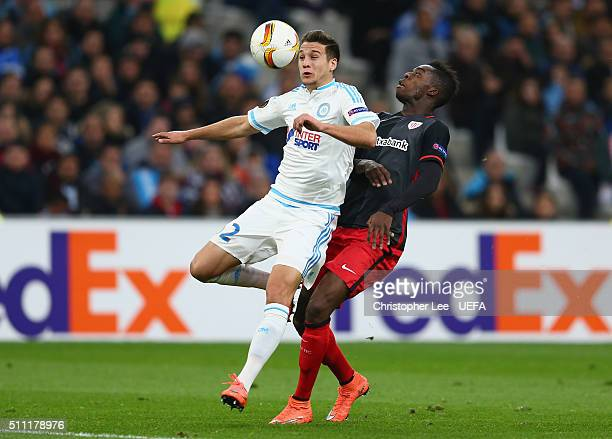 Javi Manquillo of Marseille and Inaki Williams of Athletic Club Bilbao compete for the ball during the UEFA Europa League Round of 32 match between...