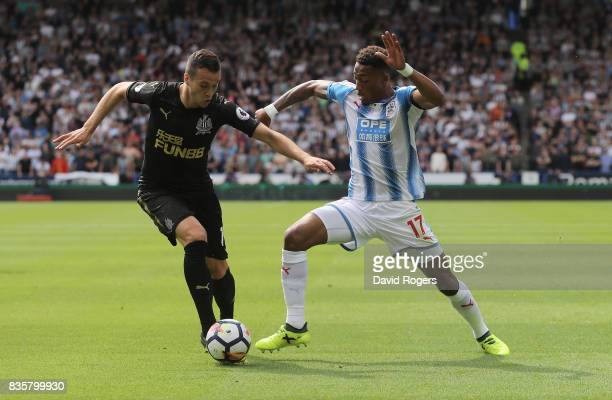 Javi Manquillo of Newcastle United and Rajiv van La Parra of Huddersfield Town battle for possession during the Premier League match between...
