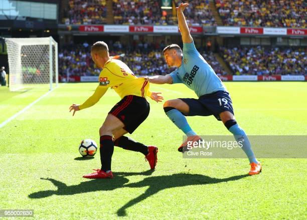Javi Manquillo of Newcastle United challenges Gerard Deulofeu of Watford during the Premier League match between Watford and Newcastle United at...
