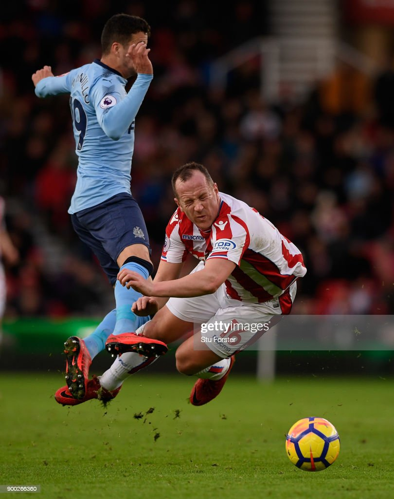 Javi Manquillo of Newcastle United fouls Charlie Adam of Stoke City during the Premier League match between Stoke City and Newcastle United at Bet365 Stadium on January 1, 2018 in Stoke on Trent, England.