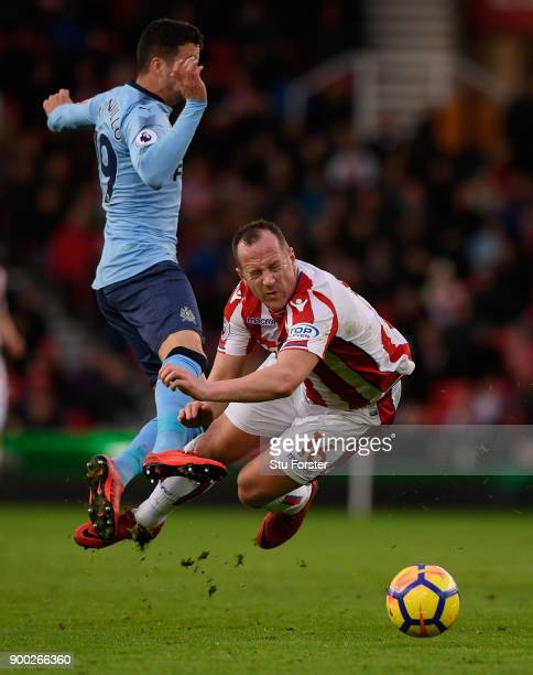 Javi Manquillo of Newcastle United fouls Charlie Adam of Stoke City during the Premier League match between Stoke City and Newcastle United at Bet365...