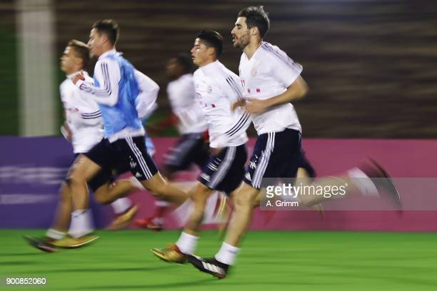 Javi Martinez and team mates run during a training session on day 2 of the FC Bayern Muenchen training camp at ASPIRE Academy for Sports Excellence...