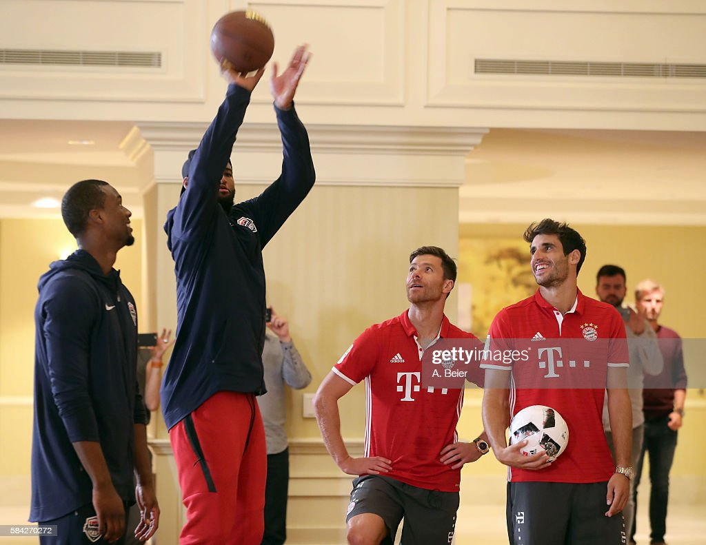 Javi Martinez (R) and Xabi Alonso (2ndR) of Bayern Muenchen watch NBA players DeMarcus Cousins (2ndL) of Sacramento Kings and Harrison Barnes of Dallas Mavericks in an activity session during the AUDI Summer Tour USA 2016 on July 28, 2016 in Chicago, Illinois.