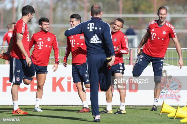 Javi Martinez Juan Bernat James Rodriguez Rafinha and goalkeeper Tom Starke of FC Bayern Muenchen warm up during a training session at the club's...