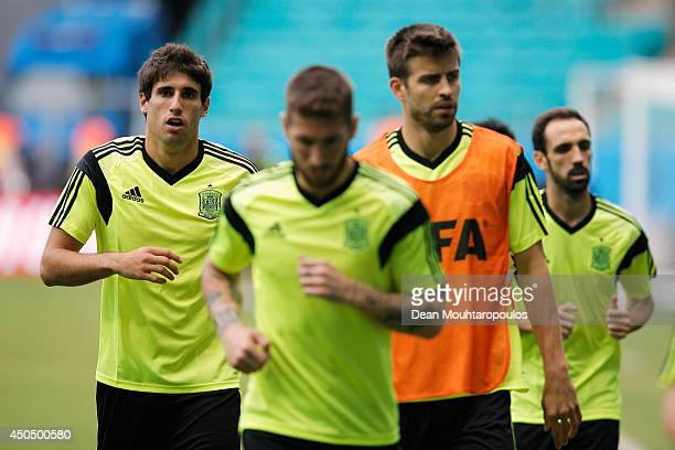 Javi Martinez looks on during the Spain training session ahead of the 2014 FIFA World Cup Group B match between Spain and the Netherlands held at the...