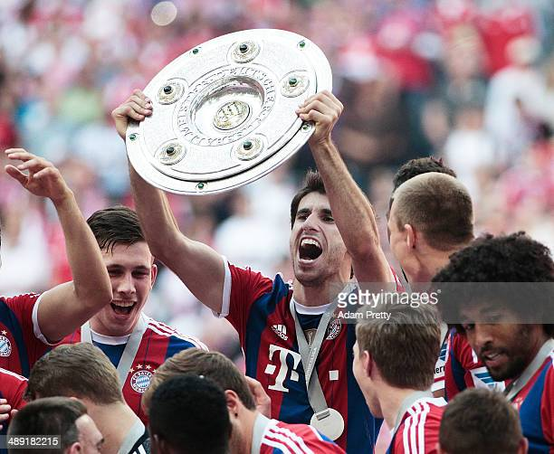 Javi Martinez of Bayern Muenchen celebrates with the Championship Trophy after the Bundesliga between Bayern Muenchen and VfB Stuttgart at Allianz...